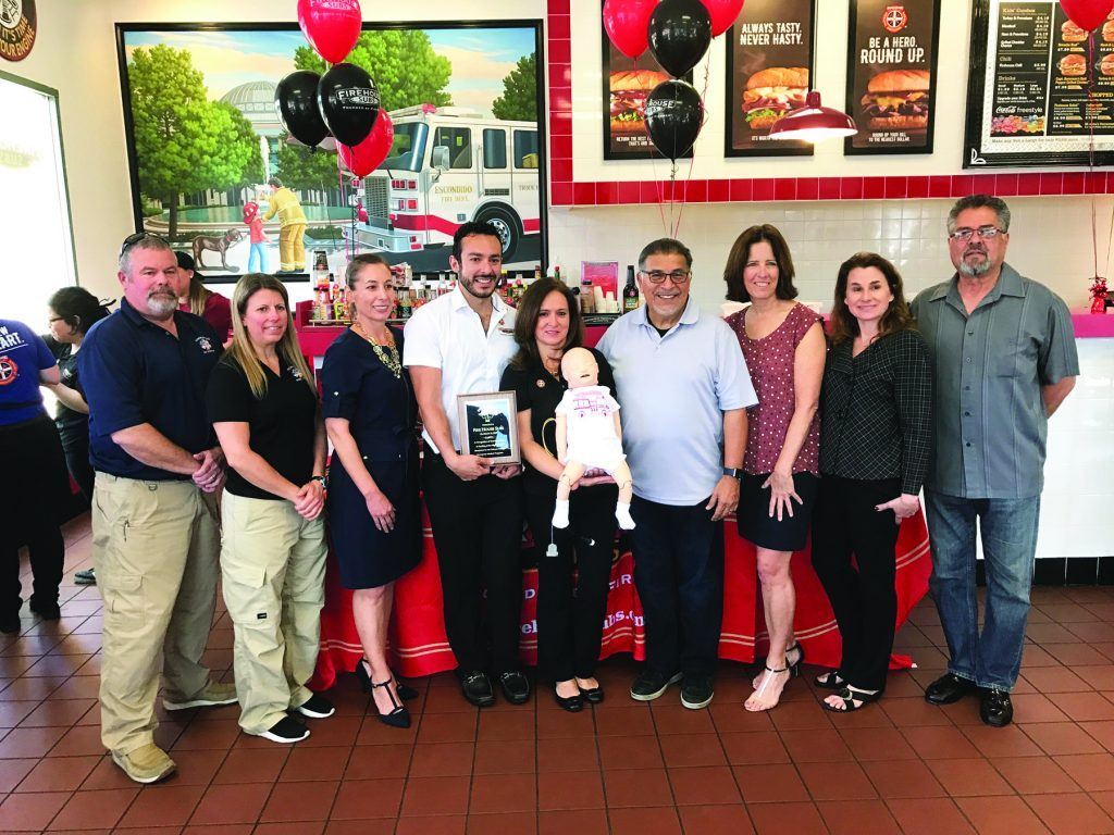 firehouse subs awards to college foundation times advocate jose eduardo ceballos and norma peabody from firehouse subs escondido chamber of commerce along representatives from palomar college foundation